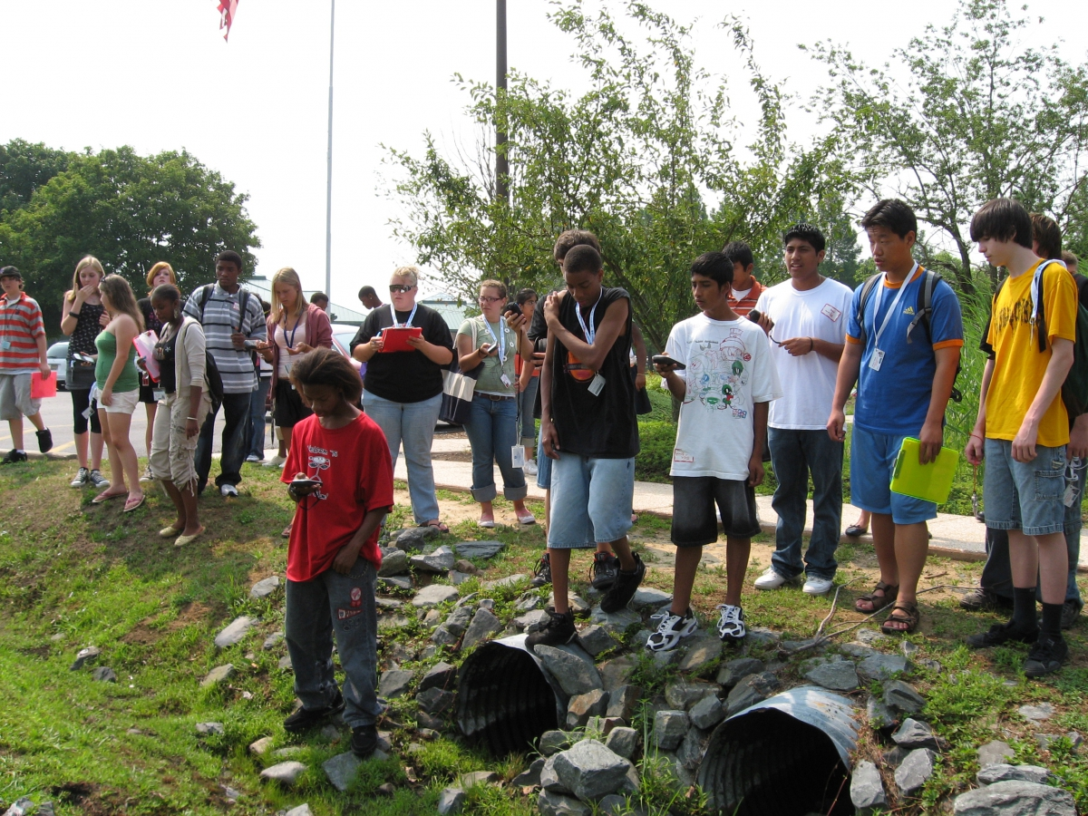 DTCC TRIO Program students using the GPS to collect storm drain locations