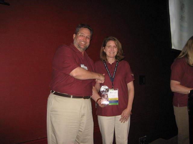Mike Mahaffie presents GIS Service Award to Nicole Minni, April 2008
