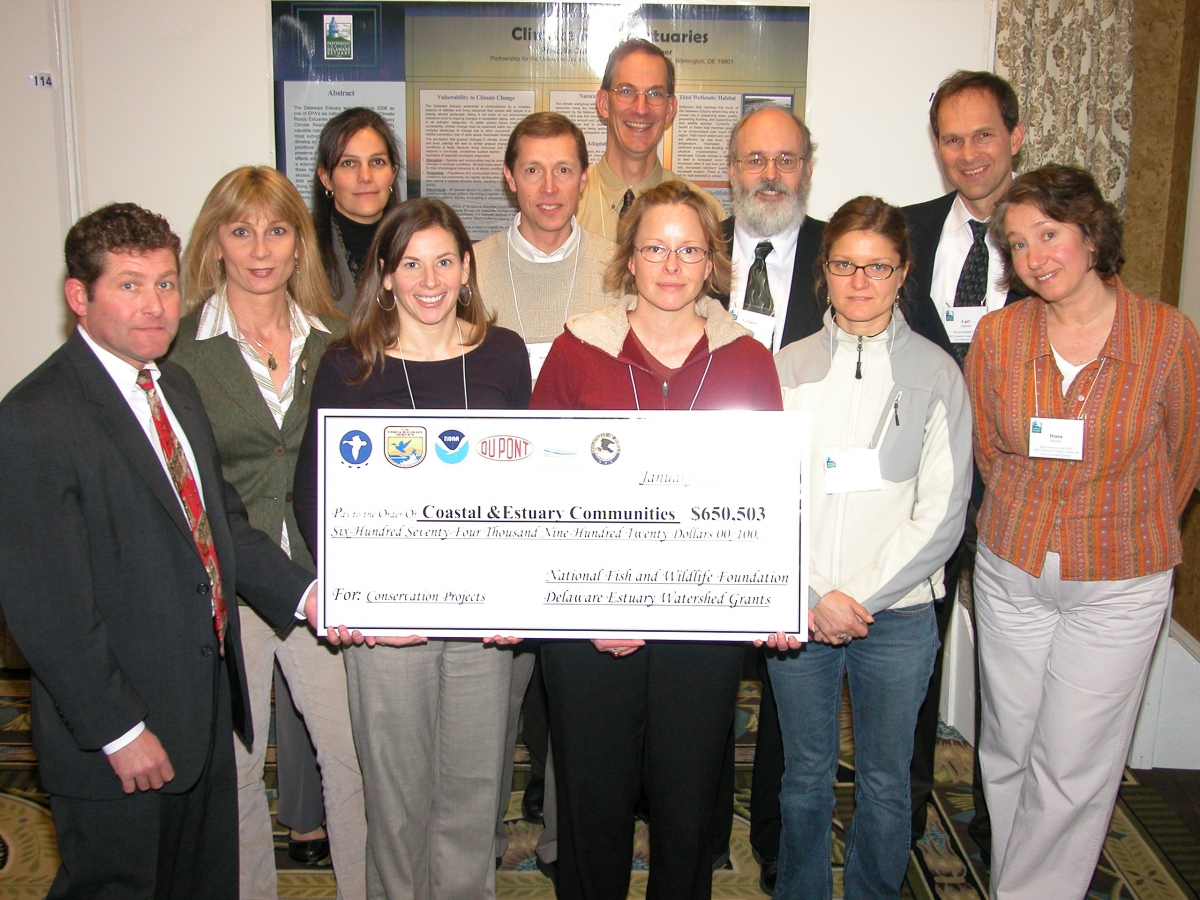 Martha Narvaez receives check from NFWF at Del. Estuary Summit in Cape May, NJ, Jan. 2009
