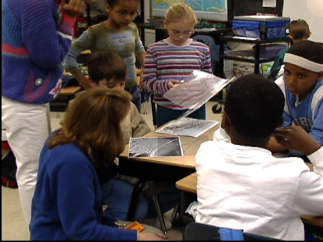 Nicole Minni explains GIS to 5th grade students