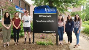 :DWRC Interns Michaella Becker (Env Eng), Alyssa Cortese (Env Sci), Liam Warren (Energy & Env Pol), Chelsea Caplinger (Poli Sci), Rebecca Steiner (Pub Pol), Natalie Zimmerman (Geol) pose in front of the Water Resources Center offices